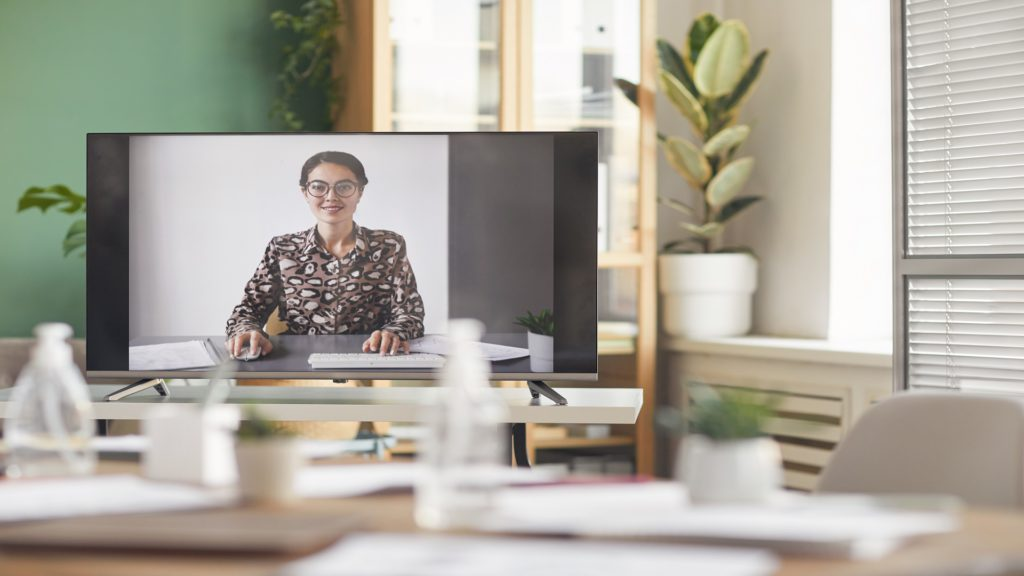 Background image of smiling businesswoman on computer screen during online business conference, copy space